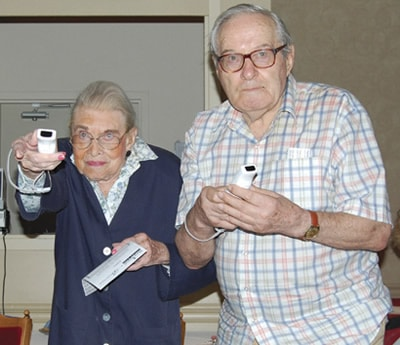 """Photo by Aidan Chafe Edith Vuchnich, 93, and Terence Bredin, 78, enjoy a simulated bowl during the """"Keeping it Sharp"""" demonstration held at Briton House retirement centre"""