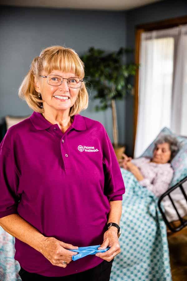 Caregiver assisting senior client in home